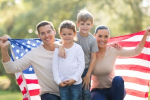 Family-of-four-holding-an-American-flag